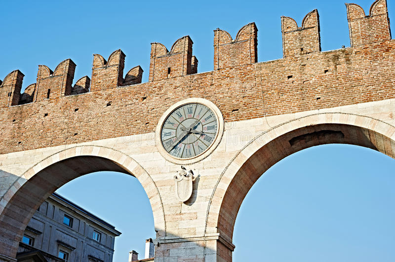 The city wall with a clock in Verona. Italy royalty free stock images