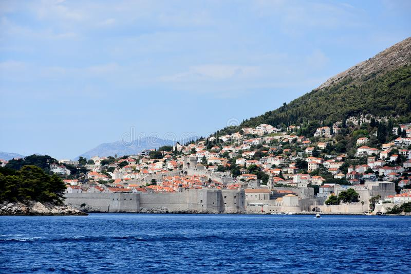 City wall of Dubrovnik. City wall at rocky coast of Dubrovnik, Croatia.Always there are many tourists walking over the wall royalty free stock image