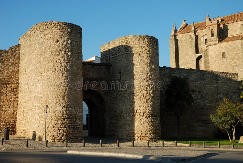 City wall with gate in Ronda. Old city wall with gate in Ronda, Spain royalty free stock images