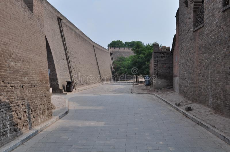 City wall of Pingyao, China. Defensive city wall and street view with trees of the anciente city of Pingyao, Shanxi, China royalty free stock images