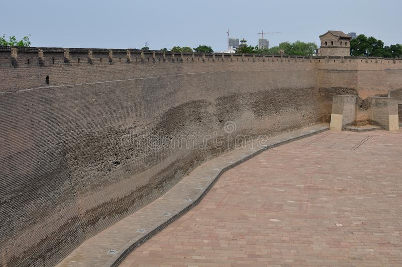 City wall of Pingyao, China. Defensive city wall and street view with trees of the anciente city of Pingyao, Shanxi, China stock photo