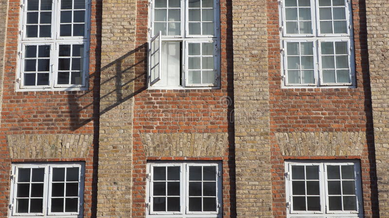 City wall with windows stock photo