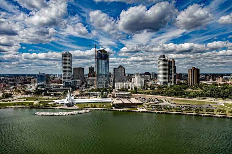 City at Waterfront Against Cloudy Sky stock photo