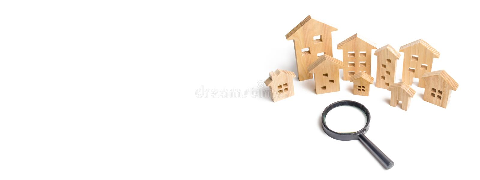 City of wooden houses on a white background. The concept of urban planning, infrastructure projects. Buying and selling real. Estate, building new buildings stock photo