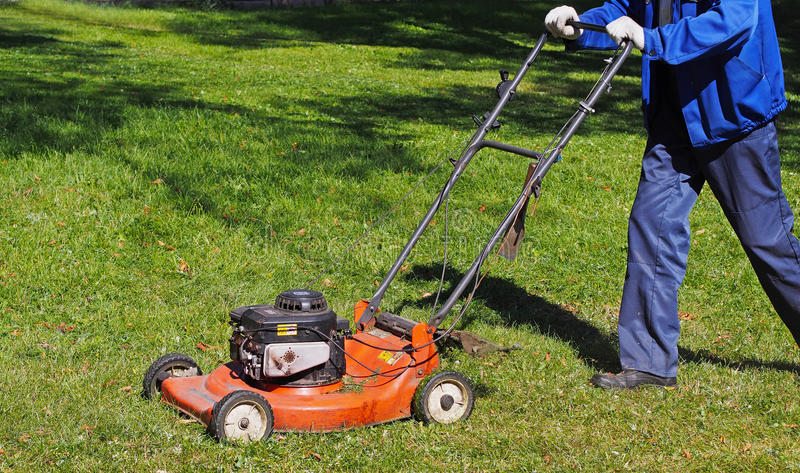 City workers - summer lawn mowing. Spain royalty free stock image