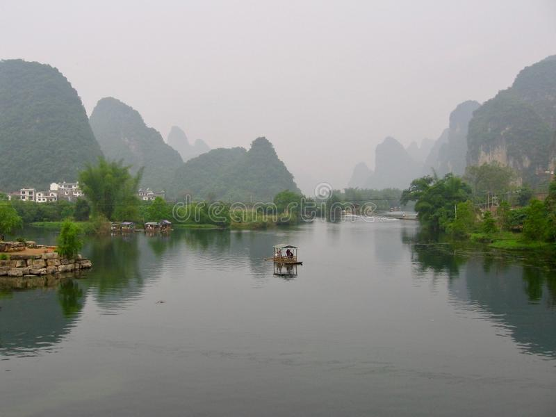 The city of Yangshuo, China with the town nestled in karst mountains in the mist and clouds. The city of Yangshuo, China near Guilin with the town nestled in royalty free stock photos