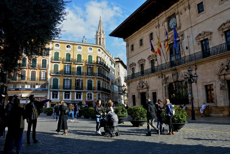 Citylife in Palma de Mallorca with  people walking around in a amazing square with architecture stock photos
