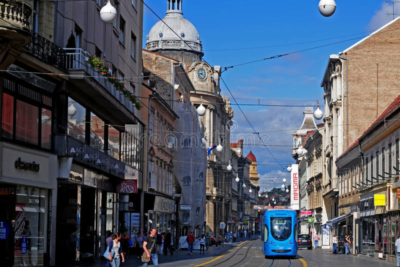Citylife of Zagreb, Croatia. CROATIA, ZAGREB - AUGUST 9: People travel along city street with old houses by tram in Zagreb, Croatia on August 21, 2011. Zagreb royalty free stock photos