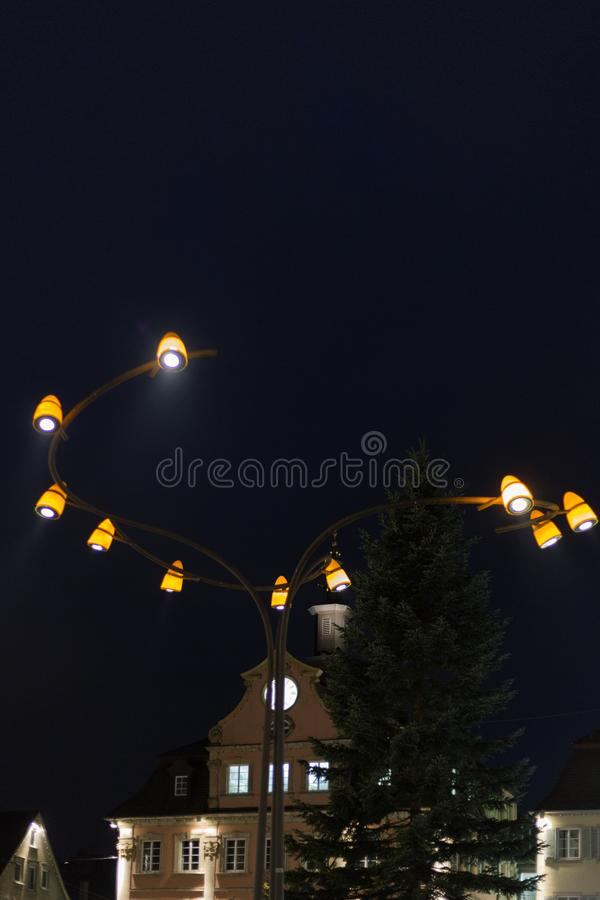 Citylights at night with facades and architecture of a marketplace. In a historical city of south germany in autumn month of november before christmas time stock image