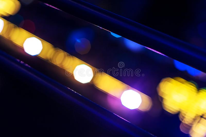 Citynight neon color blur bokeh background. An city night neon color blur bokeh background royalty free stock images