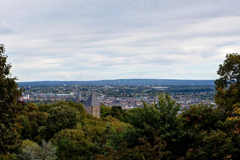Cityscape Aachen, Germany. Cityscape and landscape of Aachen, Germany, situated in a valley in North Rhine Westphalia with trees royalty free stock image
