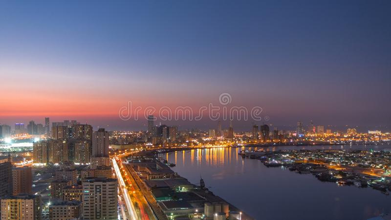 Cityscape of Ajman from rooftop day to night timelapse. Ajman is the capital of the emirate of Ajman in the United Arab Emirates. stock photos