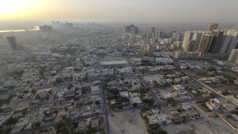 Cityscape of Ajman from rooftop morning after sunrise timelapse. Ajman is the capital of the emirate of Ajman in the United Arab E royalty free stock photos