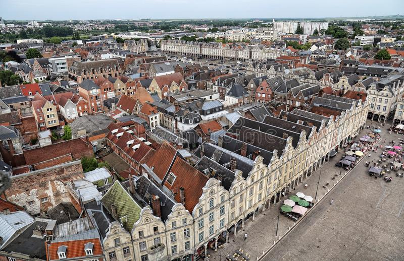 Cityscape of Arras, France. Arras, France - May 28, 2017: View from the city hall tower of people sitting at restaurants on the Place des Heros market place or royalty free stock photo