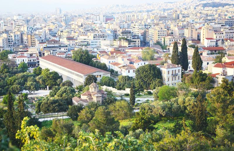 Cityscape of Athens Greece as seen from Acropolis - the ancient Stoa of Attalos and an old church view royalty free stock images
