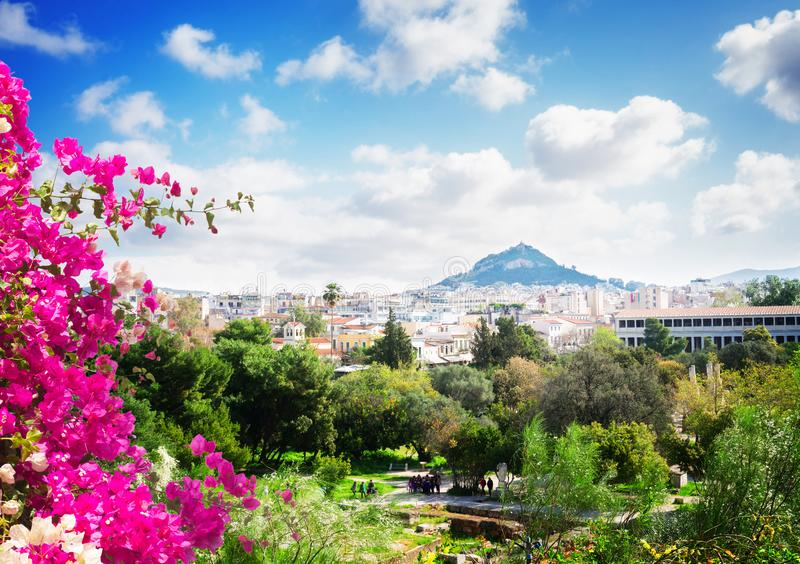 Cityscape of Athens with Lycabettus Hill. Cityscape of Athens with Agora and Lycabettus Hill, Greece with flowers royalty free stock photo