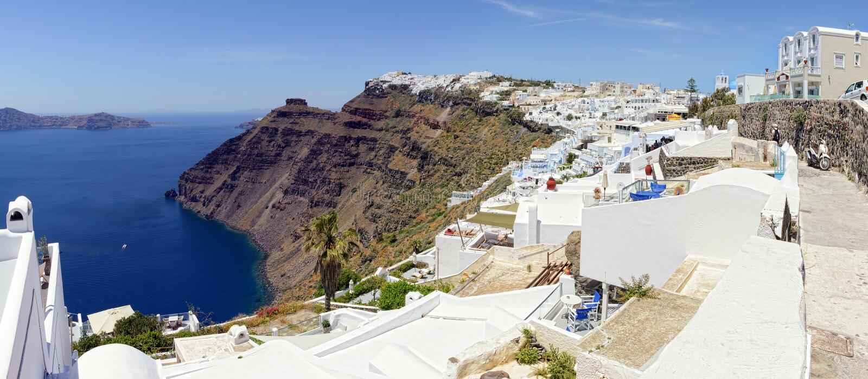 Cityscape av Fira, stad på nollan för Santorini ö Grekland och Caldera arkivbilder
