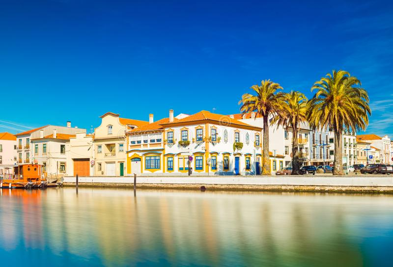 Cityscape of Aveiro, `The Portuguese Venice`, Portugal. View of embankment with colorful buildings in the traditional architecture style, canal for boats and stock photography
