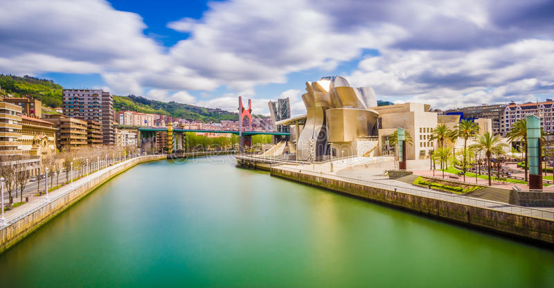 Cityscape of Bilbao. The cityscape of Bilbao, Spain. The Nervion river crosses Bilbao downtown, hosting in its margins the traditional and modern buildings of