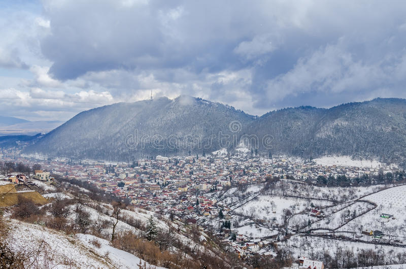 The Cityscape of Brasov City in winter time, cloudy day royalty free stock image