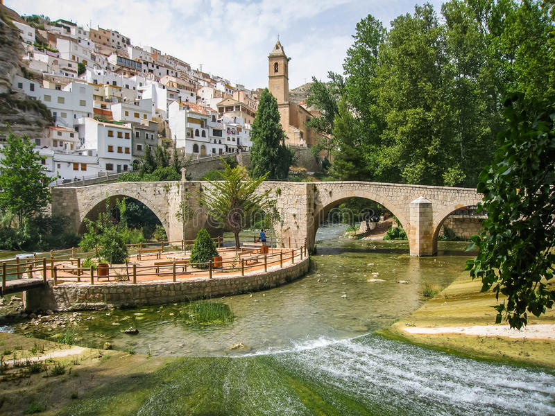 Cityscape with bridge over river at Alcala del Jucar, Castilla l. Cityscape with bridge over river at Alcala del Jucar in Castilla la Mancha, Spain royalty free stock photos