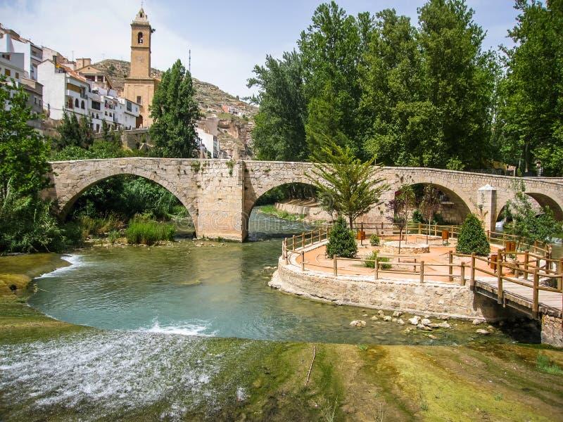 Cityscape with bridge over river at Alcala del Jucar, Castilla l. Cityscape with bridge over river at Alcala del Jucar in Castilla la Mancha, Spain stock images