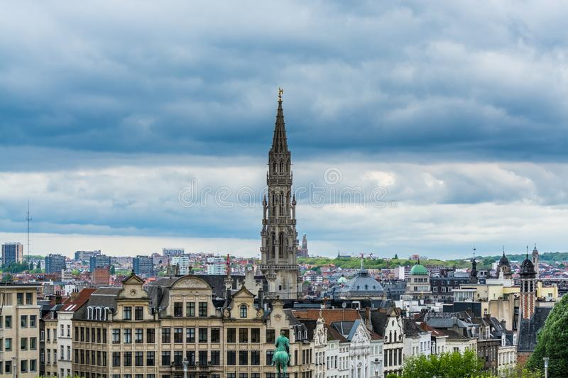 Cityscape of brussels with the landmark of tower against cloudy sky from the Monts des arts, brussels, Belgium. Cityscape of brussels with the landmark of town stock images