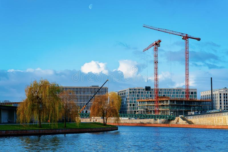 Cityscape with building construction works at Spree Riverfront Berlin royalty free stock photo