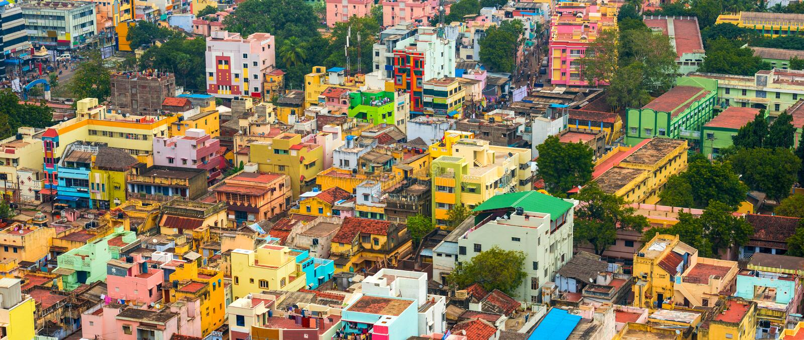 Cityscape of colorful homes in crowded Indian city Trichy, panor. Ama royalty free stock photo