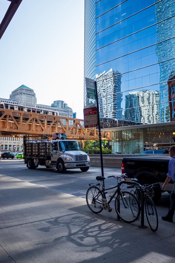 Cityscape and commuters walking, driving, biking & riding el train  in Chicago Loop stock photos