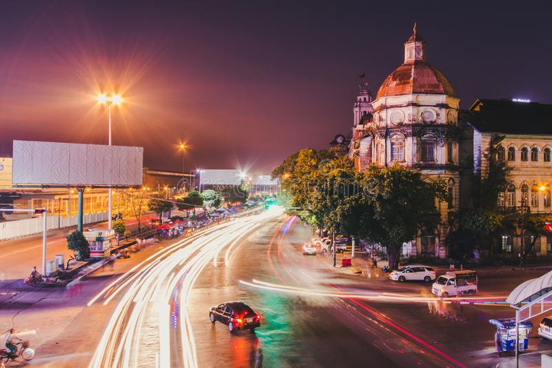 Cityscape of downtown in Yangon. At night with traffic light stock images