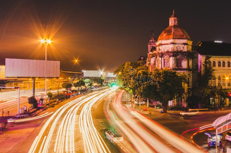 Cityscape of downtown in Yangon. At night with traffic light royalty free stock image
