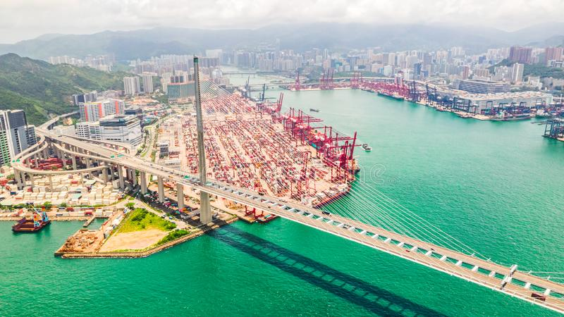 Cityscape drone aerial view of Hong Kong city, port industrial district, cargo container ship, cranes, car traffic on bridge. Cityscape drone aerial view of Hong royalty free stock photos