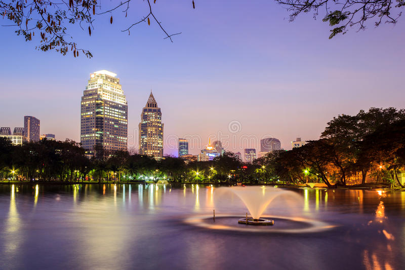 Cityscape at dusk. Cityscape view of modern buildings at Lumpini garden at dusk stock photography
