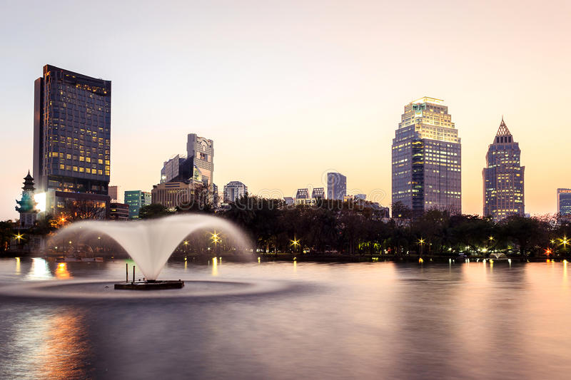 Cityscape at dusk. Cityscape view of modern buildings at public park at dusk stock images