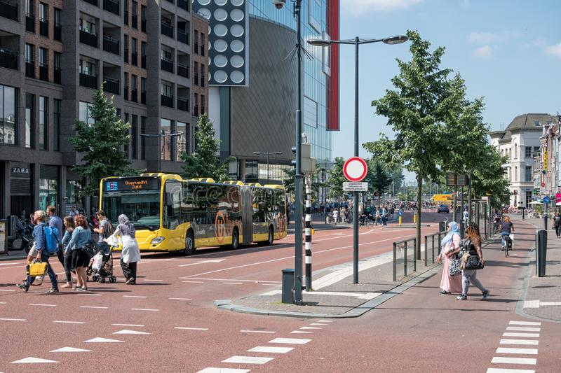 Cityscape Dutch city Utrecht with urban bus waiting for people royalty free stock photos