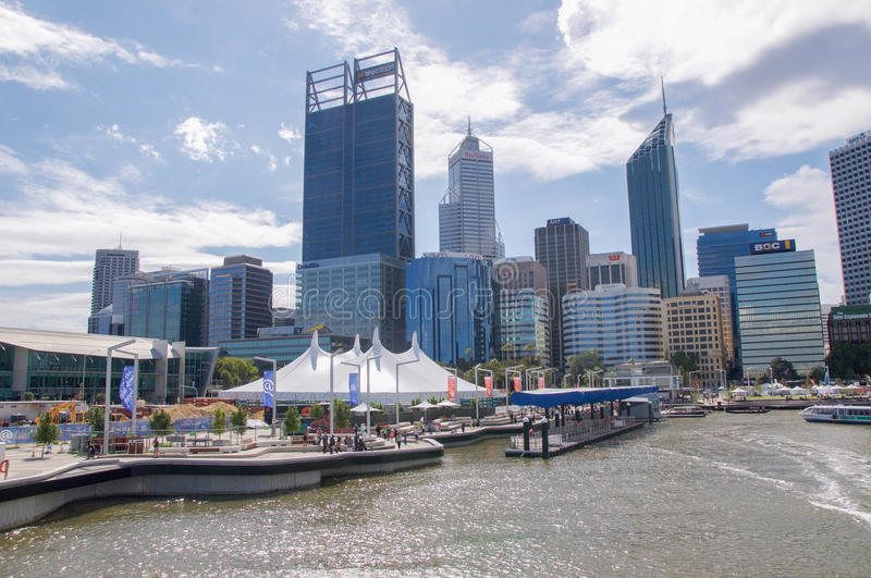 Cityscape and Elizabeth Quay in Perth. PERTH,WA,AUSTRALIA-APRIL 10,2016: Modern cityscape and Elizabeth Quay inlet with tourists and event tent in Perth, Western stock photo
