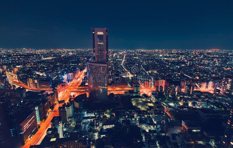 Cityscape för flyg- sikt på natten i Tokyo, Japan royaltyfri fotografi