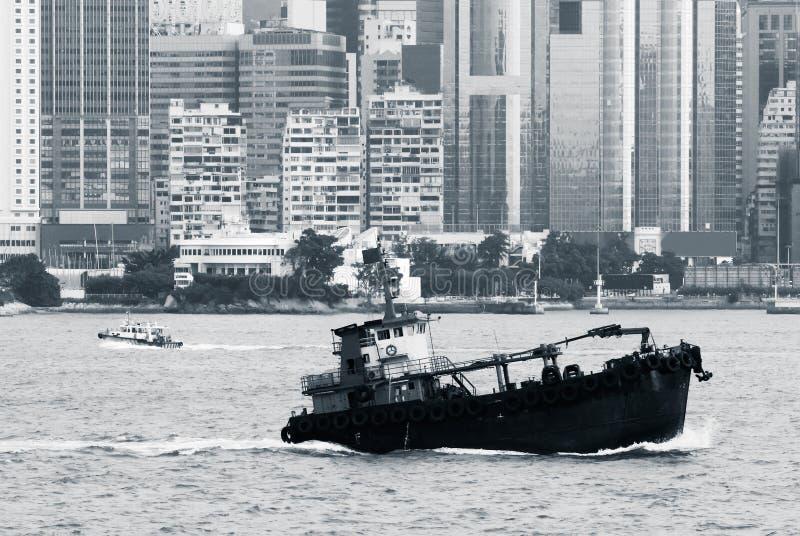Cityscape of fishing boat on Victoria harbor stock photo
