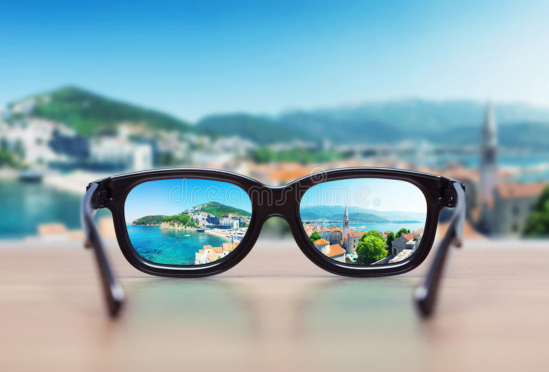 Cityscape focused in glasses lenses royalty free stock images