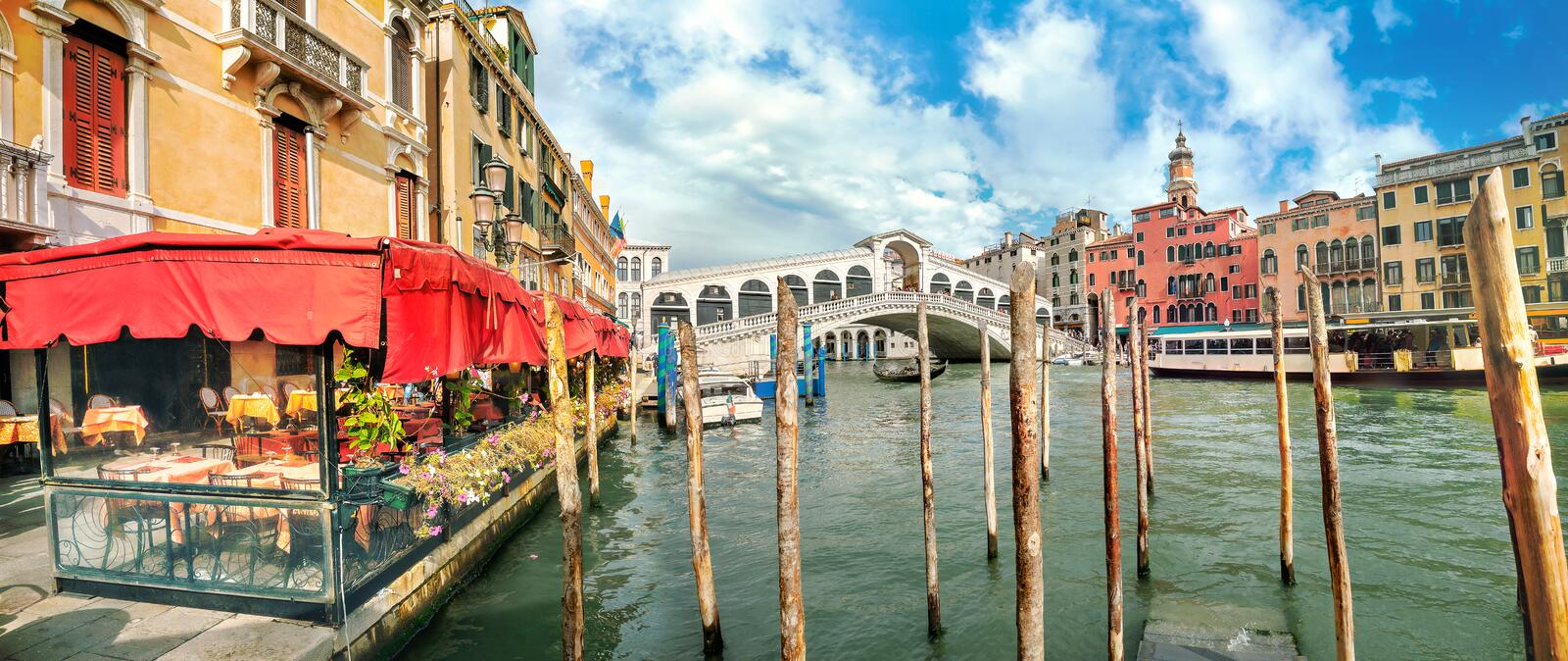 Cityscape with Grand Canal and Rialto Bridge at sunny day in Venice. Italy royalty free stock images