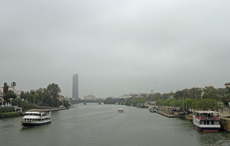 The cityscape with Guadalquivir river in Seville, royalty free stock images