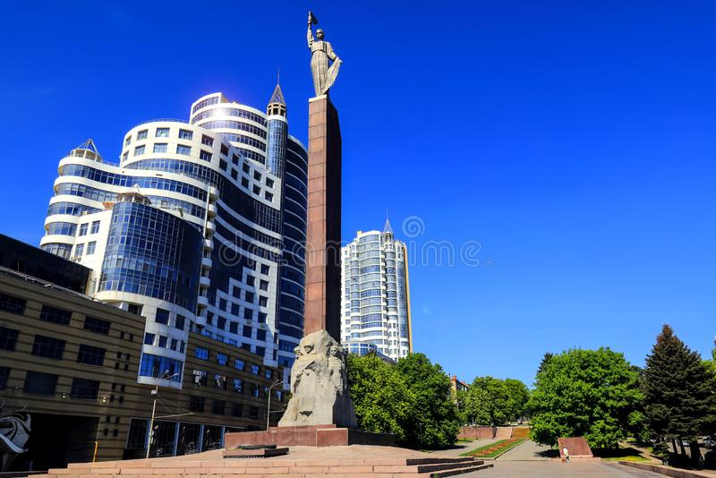 Cityscape. High towers, skyscrapers and and the monument of Glory in Dnipro city against the blue sky, Dnepropetrovsk, Dnepr stock photos