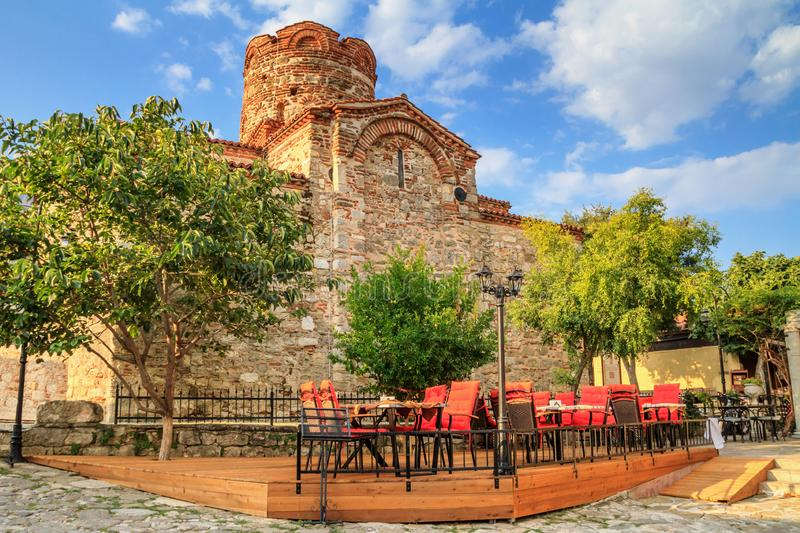 Cityscape with historic buildings - view of the Church of Saint John the Baptist in the Old Town of Nesebar. In Burgas Province on the Black Sea coast of royalty free stock image