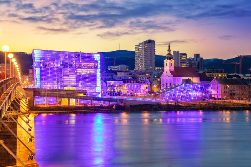 Linz, Austria. Cityscape image of riverside Linz, Austria during twilight blue hour with reflection of the city lights in Danube river royalty free stock images