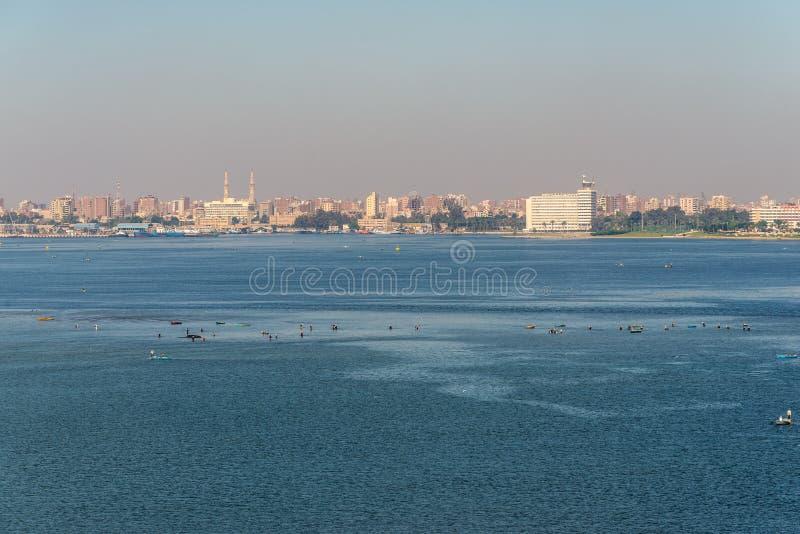 Cityscape of Ismailia, Egypt, Africa. Ismailia, Egypt - November 5, 2017: Cityscape of Ismailia on the lake Timsah from ship passing Suez Canal, Ismailia, Egypt royalty free stock image