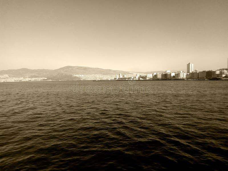 Cityscape of Izmir - Alsancak Turkey from the sea - Sepia Photography royalty free stock photos