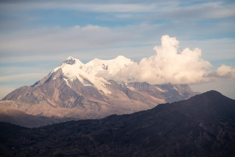 Cityscape of La Paz, Bolivia with Illimani Mountain rising in the background stock images