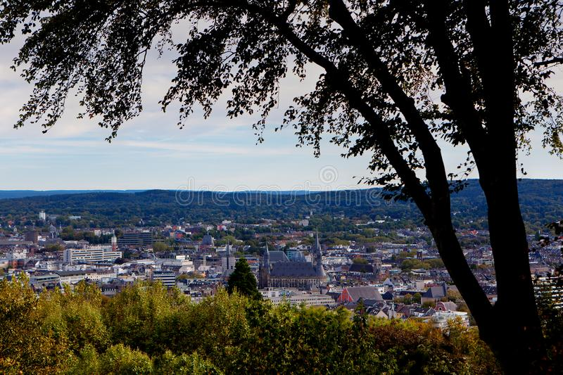 Cityscape Aachen, Germany. Cityscape and landscape of Aachen, Germany, situated in a valley in North Rhine Westphalia with trees royalty free stock photos