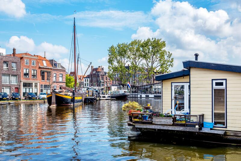 Cityscape of Leiden, The Netherlands. With a water house in the foreground stock image